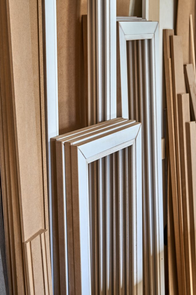 MDF cabinet door. Joinery. Disassembled glass cabinet doors in workshop. Furniture manufacture