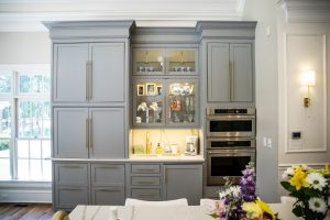 Open Concept Elegant and Spacious Kitchen with large gray custom Cabinets